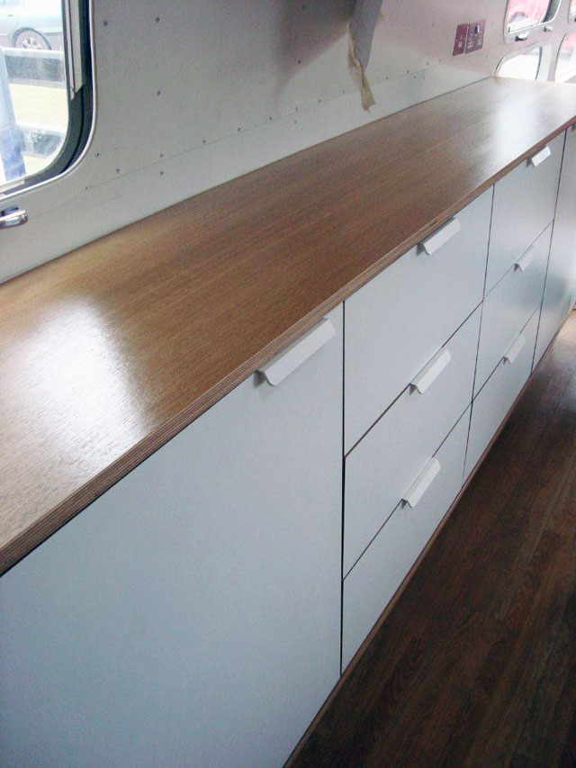Oak Airstream units get varnished