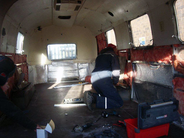 Airstream electrics and interior go in